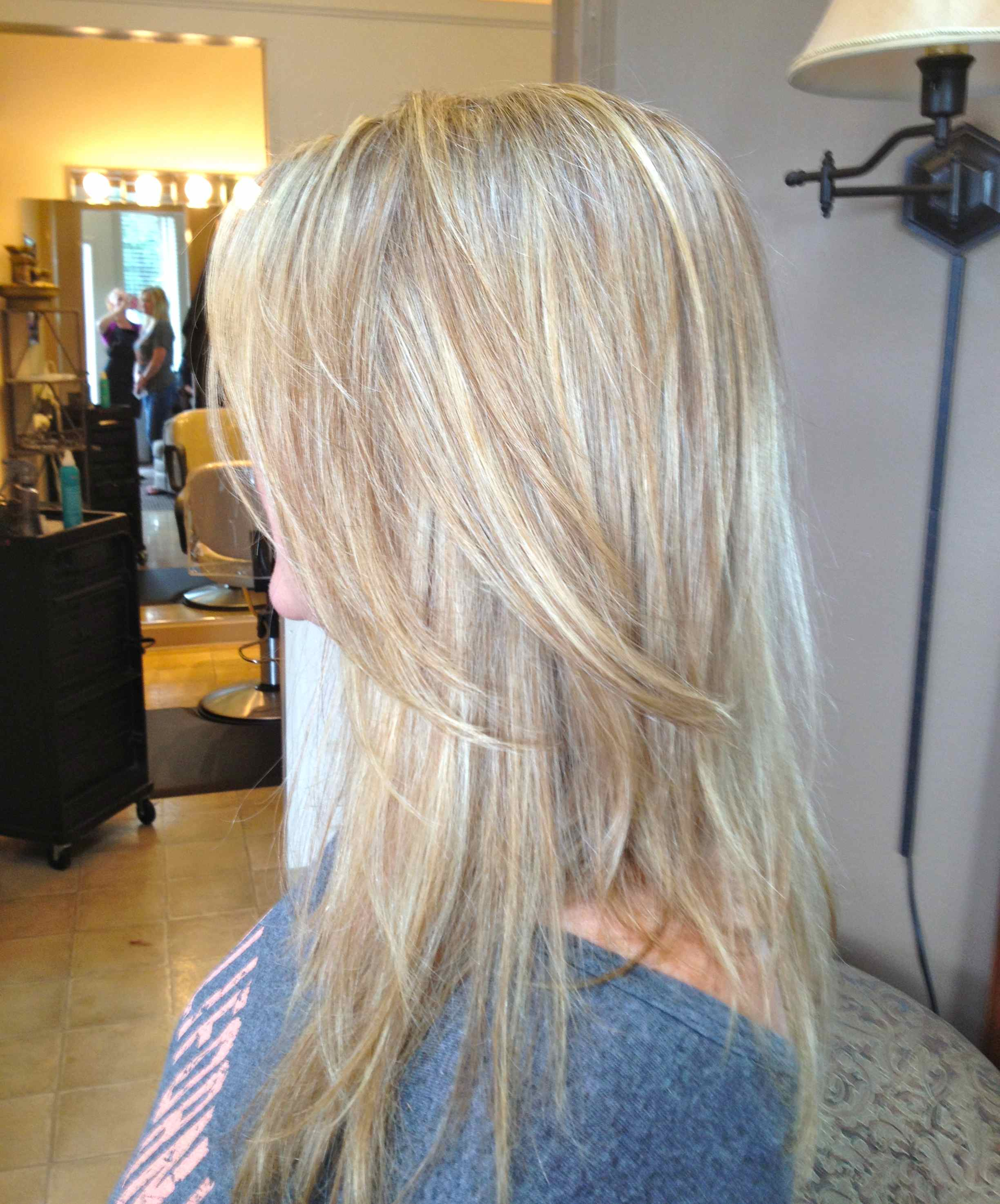 foiled highlights and warm brown lowlights, cut with long layers